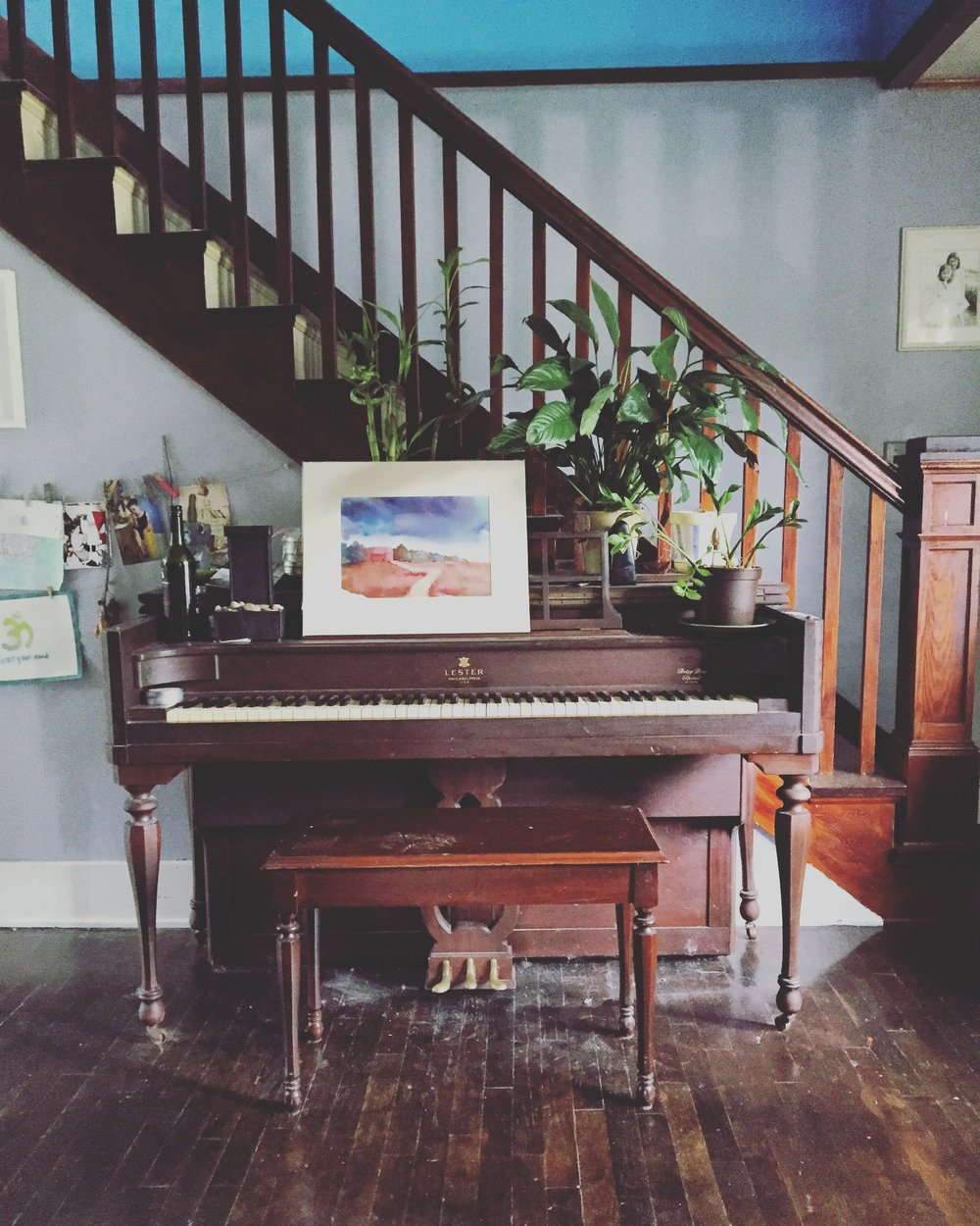 This is the view when you walk into her dining room from the living room.  Brooke is super talented in a lot of ways.  One is her piano playing skills. I love that this is the focal point of her dining room. The stairs lead up to her daughters' rooms, which I will do a tour of in a future post.  To the left are the kitchen and bathroom, and to the right is her dining table.