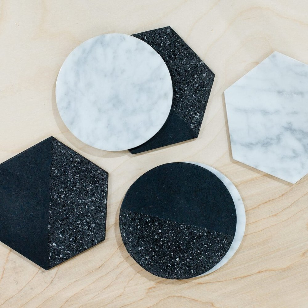 La Piedra Coasters  - $55 - Set of 6 (THIS IS A GREAT DEAL) - these are hand-carved in black volcanic rock and white marble stone, with cork bottoms to protect your tables - Takes several days to complete.