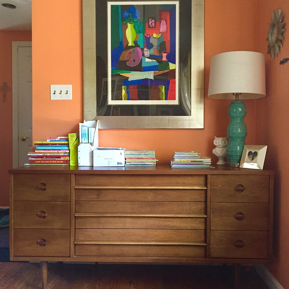 This is one of the credenzas (was once a long dresser, but now I call it a credenza cuz I'm fancy like that) in our living room.  It stores winter clothes inside, and the top holds a bunch of our kids' books so they can easily find and reach them. LOVE the drawer pulls on this one!