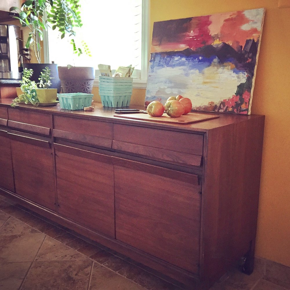 Here's a credenza that we turned into much needed extra storage and counter space in our small kitchen.  This is a storage powerhouse!