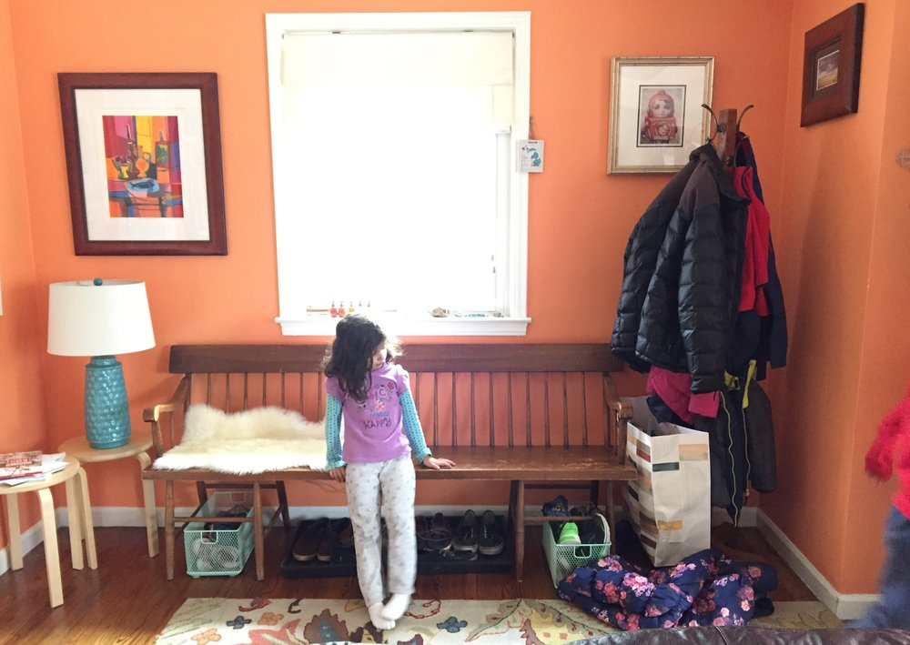 Daughter hopes mom will go away and not notice that she has not hung up the coat.  Daughter decides to wait it out and just stare at the coat.  Mom does not go away and repeats the request.