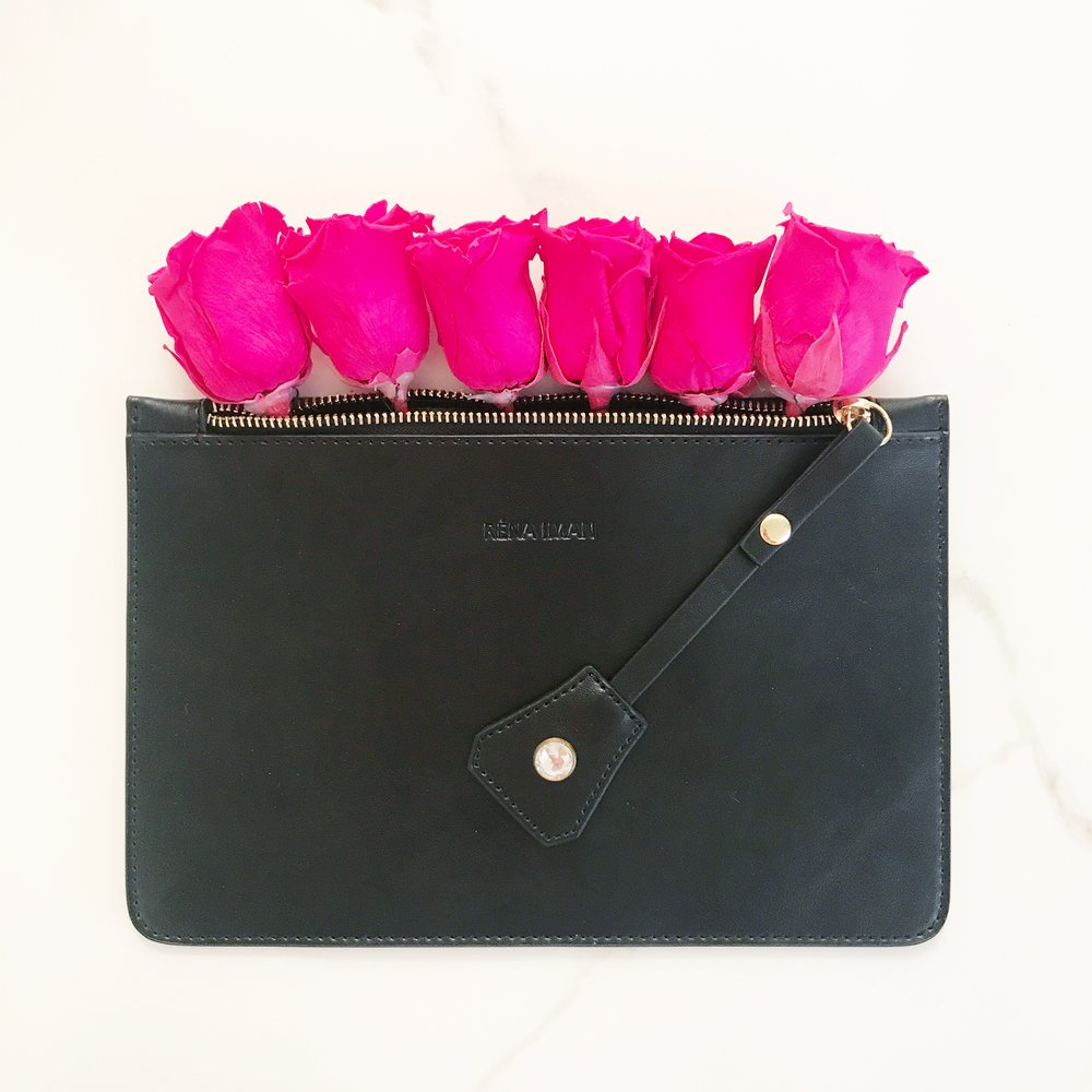 Rena Iman Black Clutch