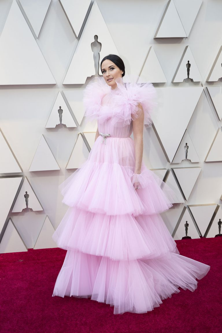 Kacey Musgraves - This Giambattista Valli dress is what all of my dreams are made of. Candy pink and tulle— I mean seriously can it get in any better? Kasey's soft features and simple hairstyle really allows the dress to do all of the talking. Everything just flows so effortlessly and I am pretty sure that I need to add this to my closet ASAP.(pc Getty Images)