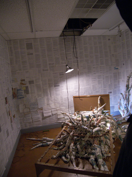 The handwritten, folded papers on the wall are pages written by a Dammasch resident -somebody known as Reverend Bob.  The pages contain drawings and statements about redemption and were accordioned then doubled over and wedged into the slats of a radiator.  Finding them was like stumbling into a gold mine.