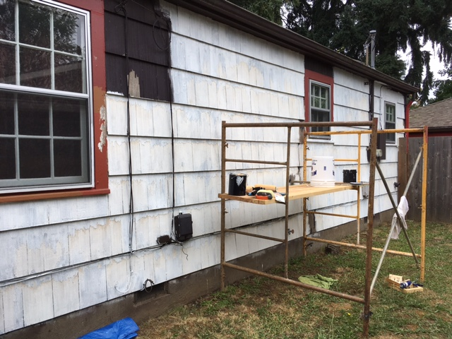 Staining was visible in the scraped zone of the lead-binding primer, so i went over it with Kilz.  re-caulked the windows, etc.... all the prep took a LOOONG time.  Also, in that time frame, we had 105F weather, so I did not work on those days (there were 2 days of that.)