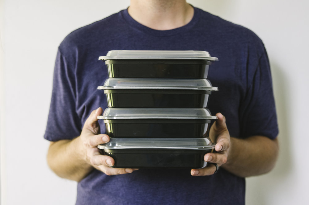 Branding Portrait of a man holding boxed meals