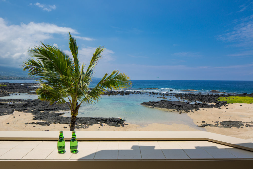 $  1,850,000 Cash on January 16, 2018      Kona Bay Estates #21  is located directly in front of calm tidal pools in Kailua Kona.This modern angular designed home has an elevator and 3 massive skylights!