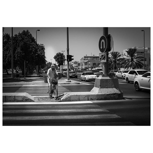 Zebra crossing. Wow Abu Dhabi was quiet today during my walk, this was the only person I crossed paths with. Strange. . #myabudhabi #inabudhabi #fujifilm @fujifilmme #streetphotography #lensculturestreets #street_photography #streetphotographers #streetlife #streets #everybodystreet #photojournalism #peoplescreatives #lensculture #streetlife_award #streetdreamsmag #documentaryphotography #streetphotographer #documentaryphotographer #beststreets #reportagespotlight #everydayeverywhere #streetactivityteam #streetdreamsmag #fotograferjomblo #streetactivity #urbanandstreet #imaginatones #streettogether #bestofstreet