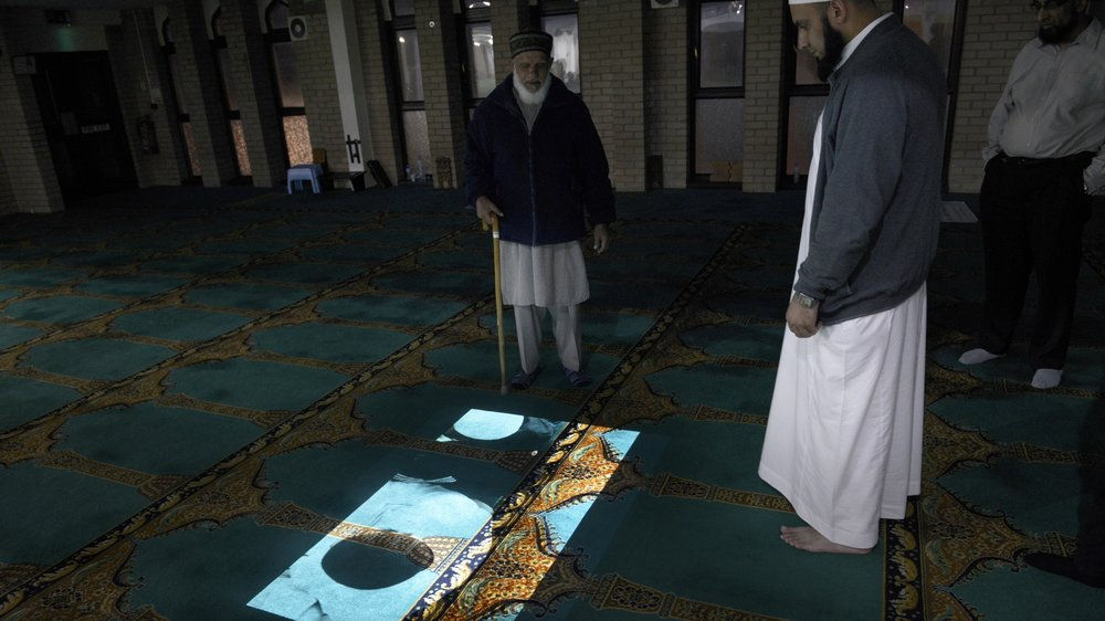 Documentation of moving projection, Birmingham Central Mosque.