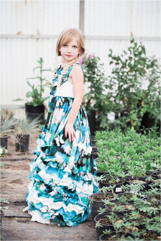 Little_girl_in_silk_gown_in_greenhouse.jpg