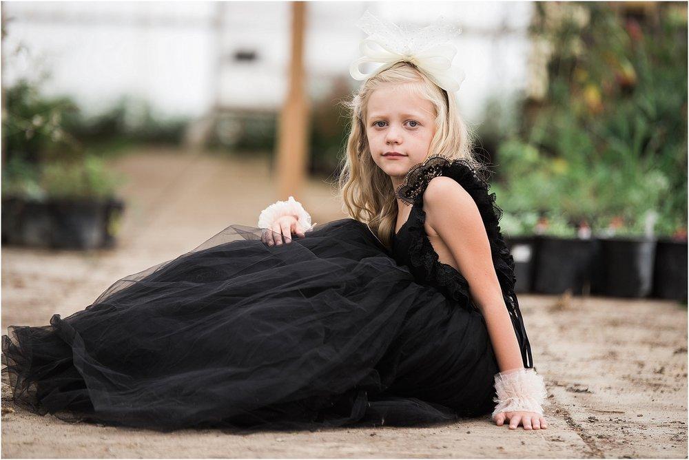 Girl_sitting_in_greenhouse_wearing_dollcake_frock.jpg