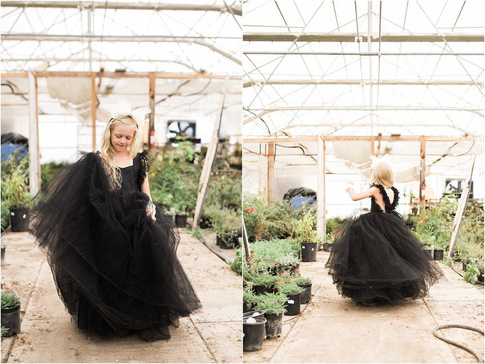 Little_girl_spinning_in_greenhouse.jpg