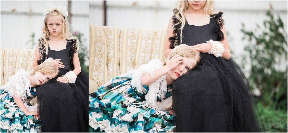 Sisters_wearing_designer_dresses_on_vintage_chair.jpg