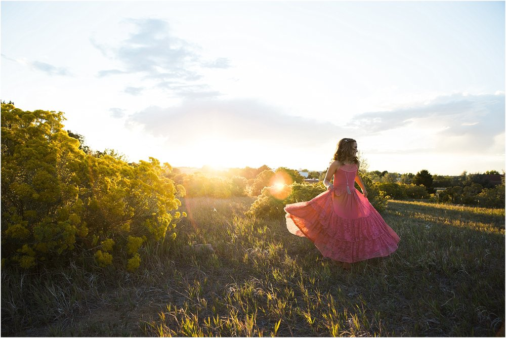 girl_spinning_in_boho_dress_at_sunset.jpg