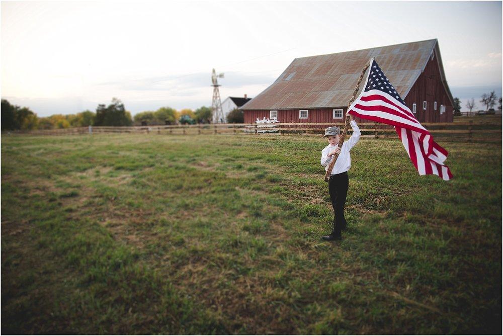 boy_waving_flag_with_red_barn_behind.jpg
