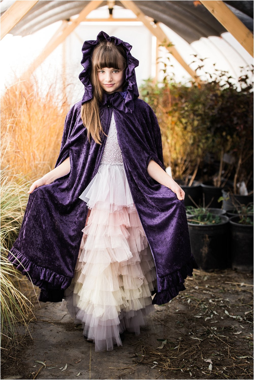 girl_in_hooded_cloak_in_greenhouse.jpg
