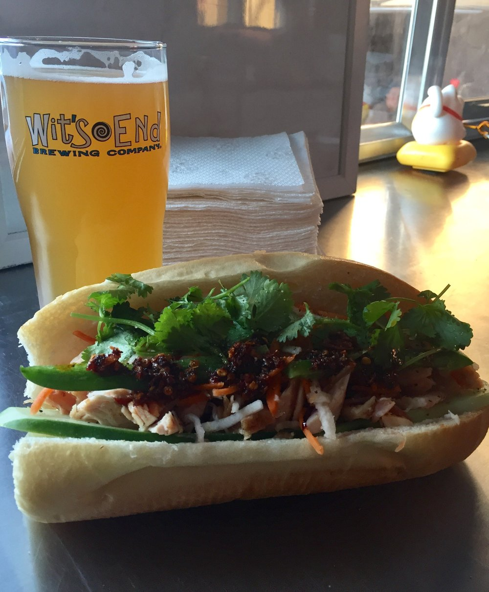 Chicken banh mi with our spicy oil and a brew at Wit's End Brewery!