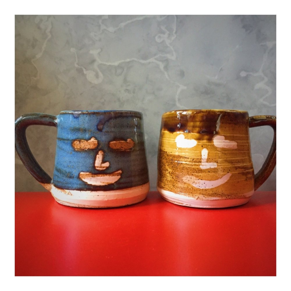 Pair of Face Mugs