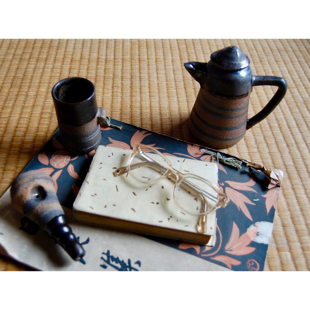 lifestyle teapot and cup and pipe.jpg