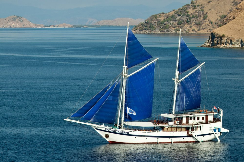 The Indo Aggressor is a traditional Phinisi Sailboat turned liveaboard yacht.