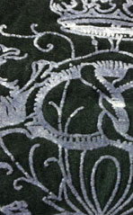 Flocking   Specialty technique used to achieve a raised, velvet like embellishment.