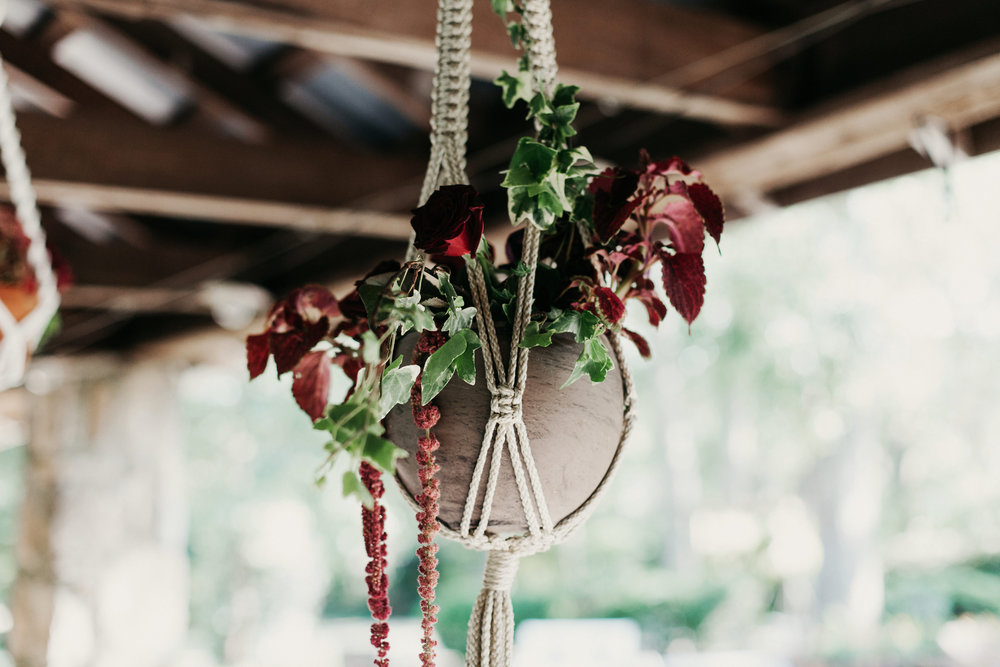 Floral hanging macrame centerpiece for wedding reception.