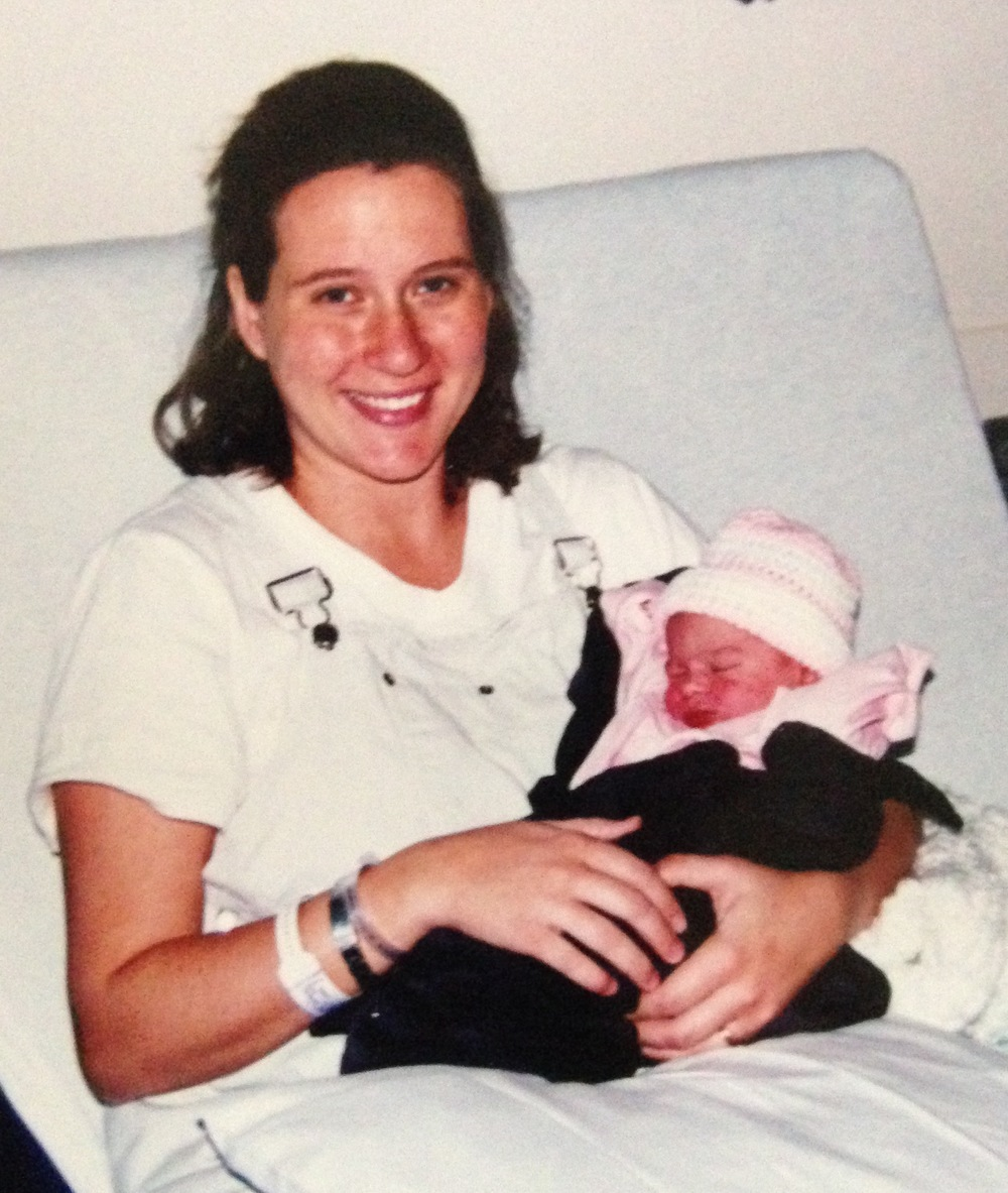 Midwife with her own baby