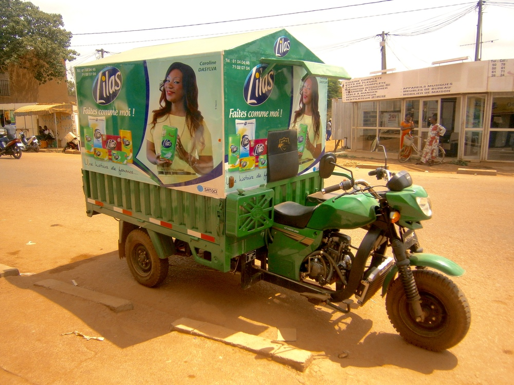 "In Ouagadougou, Burkina Faso, menstrual pads are delivered to small stores using classy scooters like this one!  However, the cost of pads is relatively high and these types of ""conveniences"" are only available to a small group of girls and women."