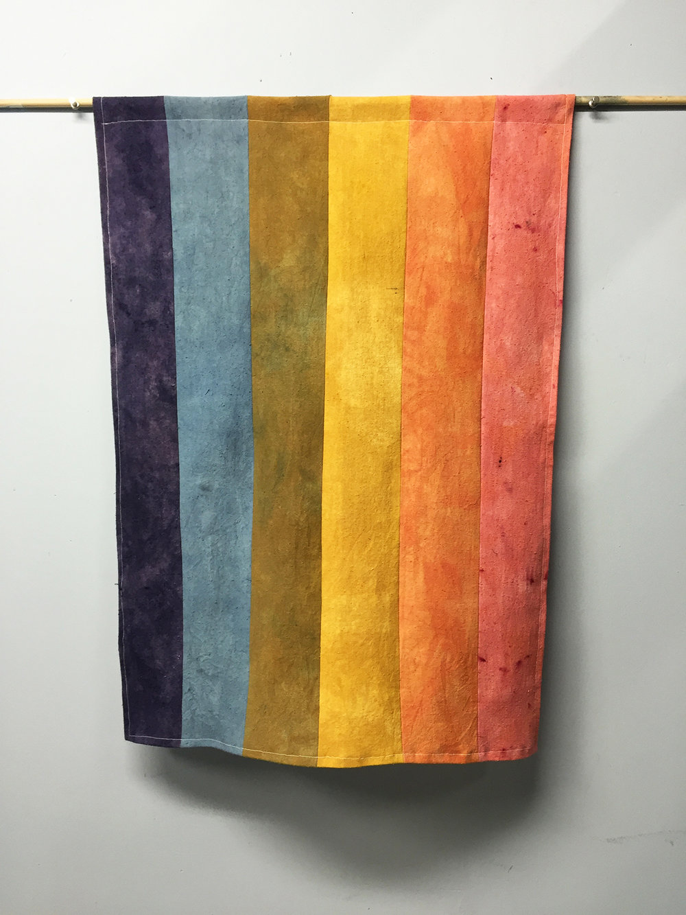 Naturally dyed Pride Flags are for sale on the Wax & Wane Fiber website.