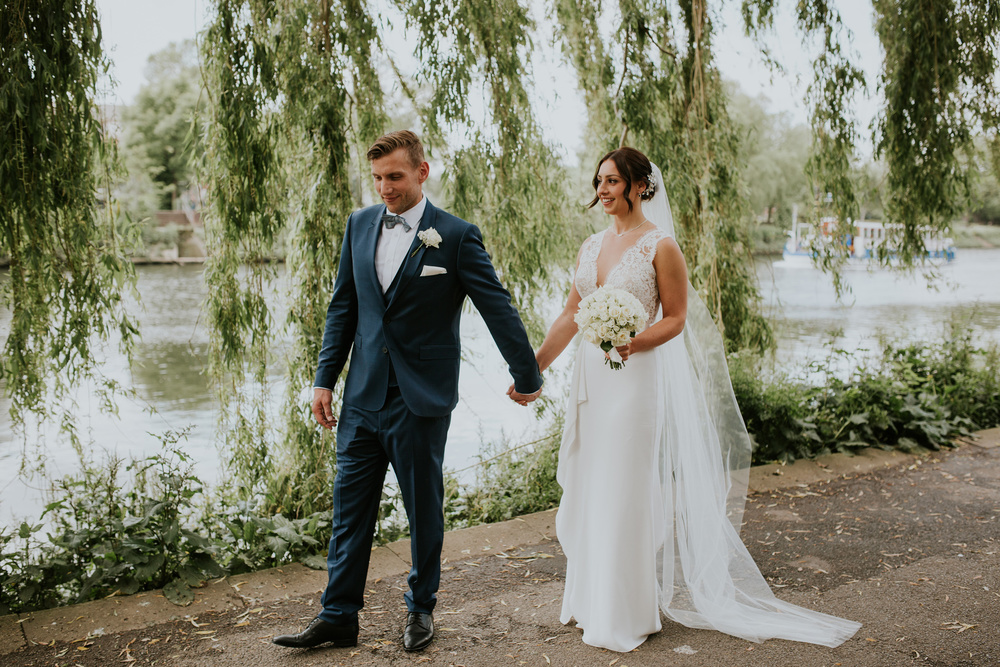 The Bingham wedding photographer couple walking on the tow path Suzanne Neville wedding dress