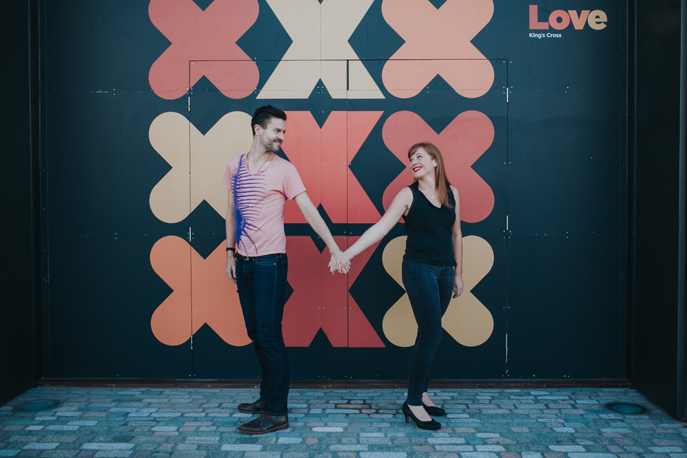 graphic-crosses-background-London-engagement-session-Kings-Cross-couple-portraits