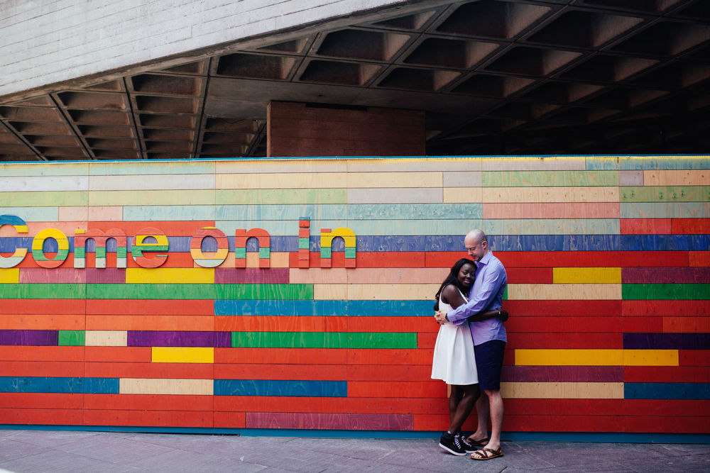 London Southbank engagement photographer couple portraits colourful background