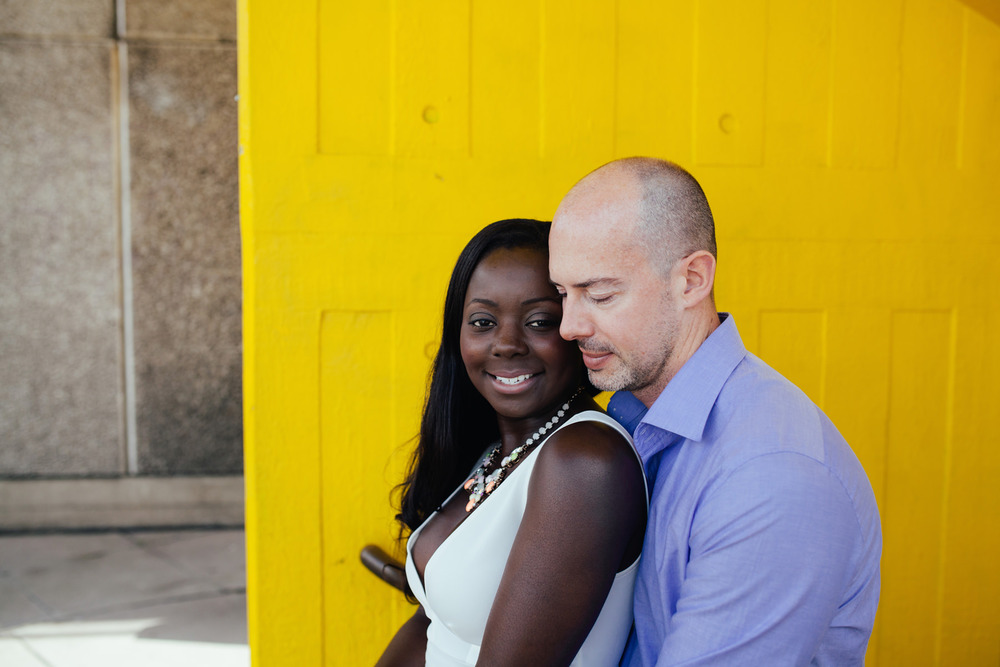 London-Southbank-engagement-photographer-couple-standing-in-yellow-stairwel