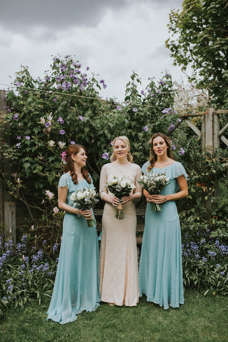 LD-94-bride-bridesmaids-with-white-rose-bouquets-portraits-garden.jpg