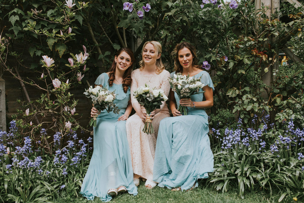LD-100-London-bride-bridesmaids-with-white-rose-bouquets-portraits-garden.jpg