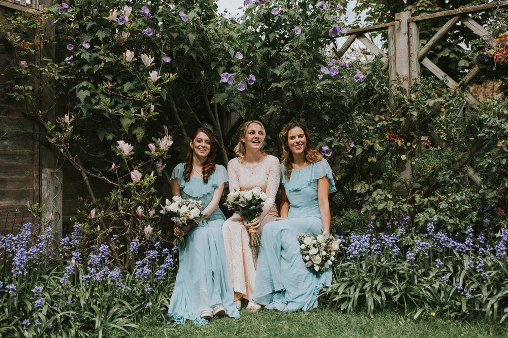 LD-105-London-bride-bridesmaids-with-white-rose-bouquets-portraits-garden.jpg