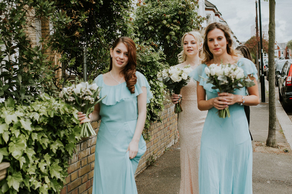 LD-124-London-bridesmaids-blue-dresses-bride-walking-to-wedding-ceremony.jpg