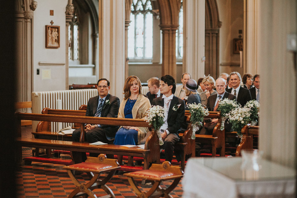 LD-165-groom-waiting-catholic-church-Clapham-common-wedding.jpg