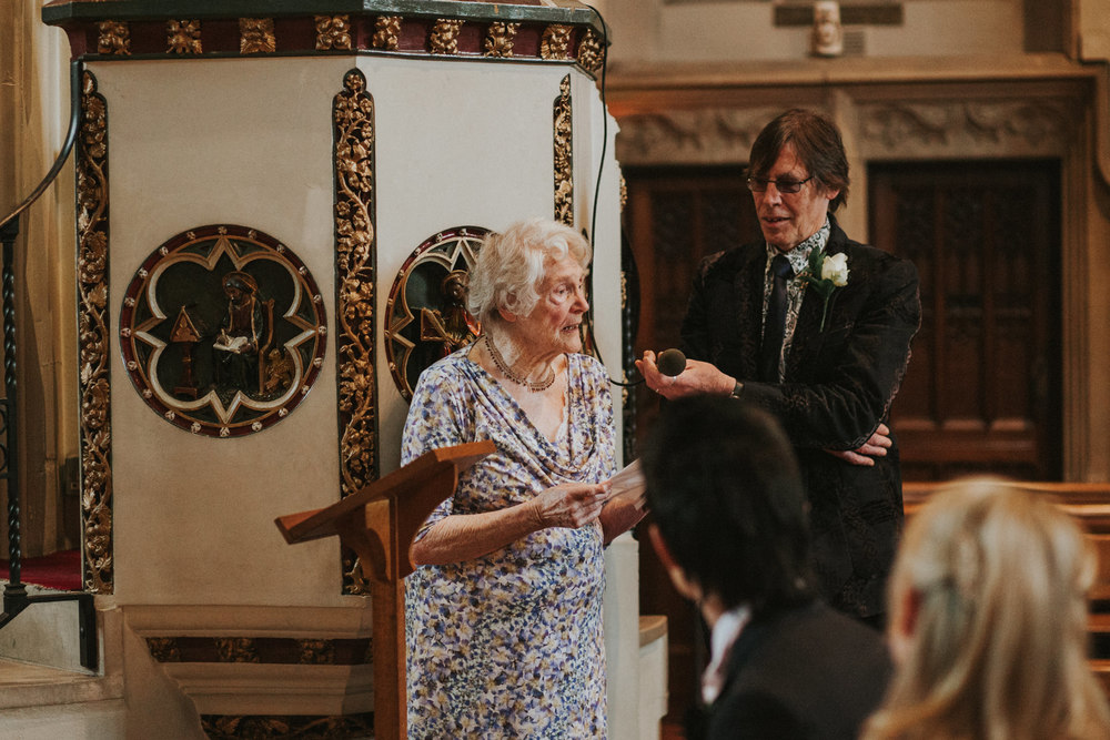LD-190-London-wedding-grandma-reading-during-ceremony.jpg