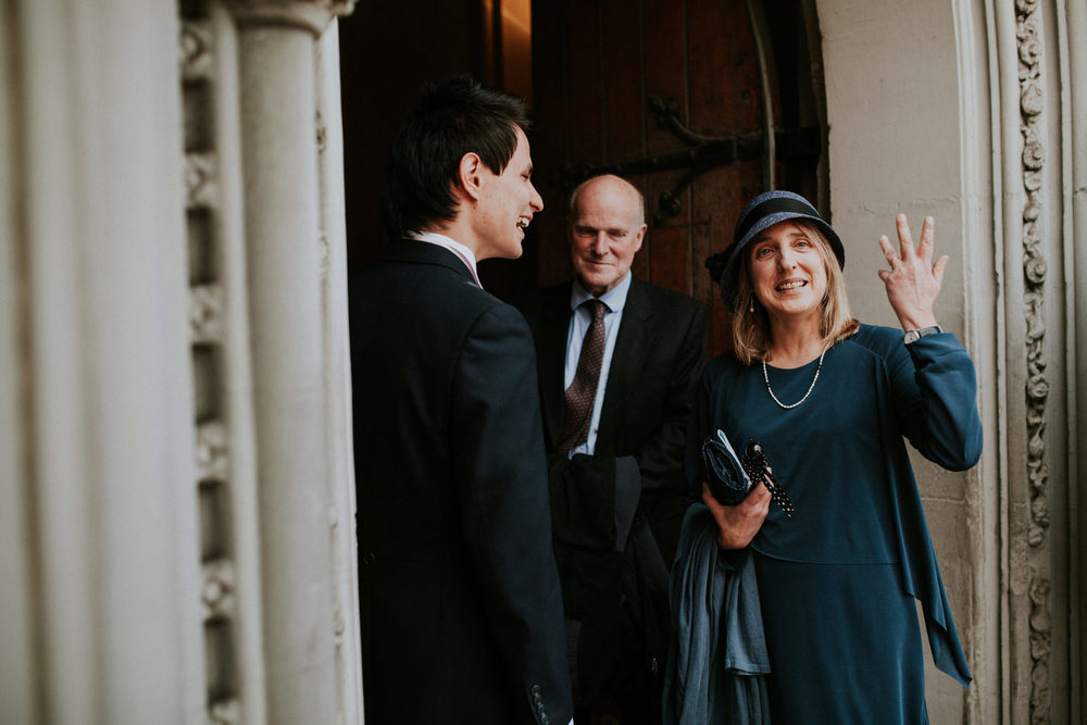 LD-347-guest-candids-outside-St-Marys-Clapham-London-reportage-wedding.jpg