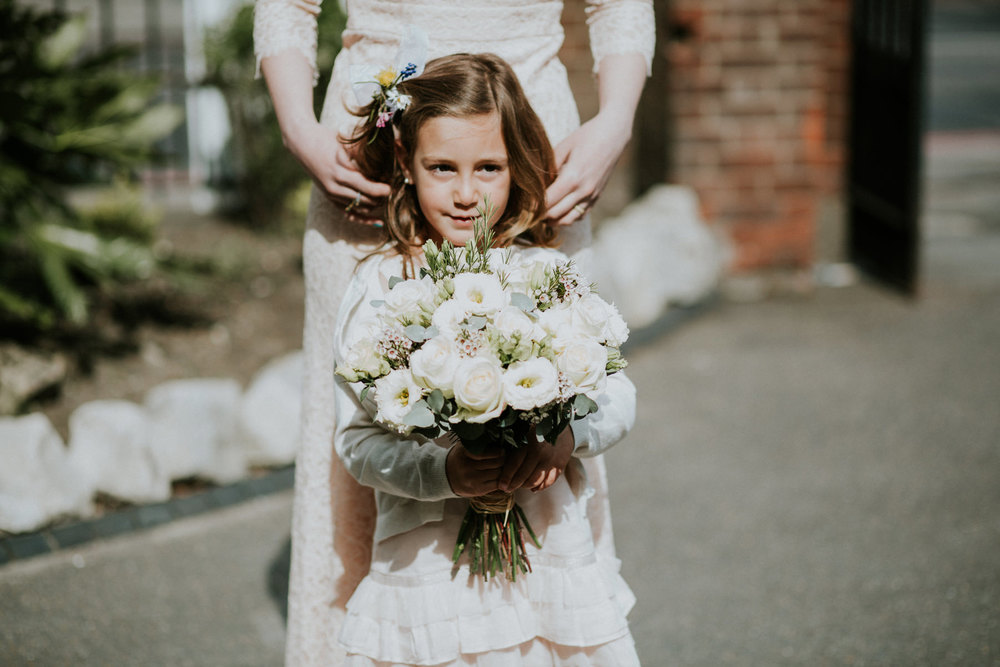 LD-368-flowergirl-outside-St-Marys-Clapham-London-reportage-wedding.jpg