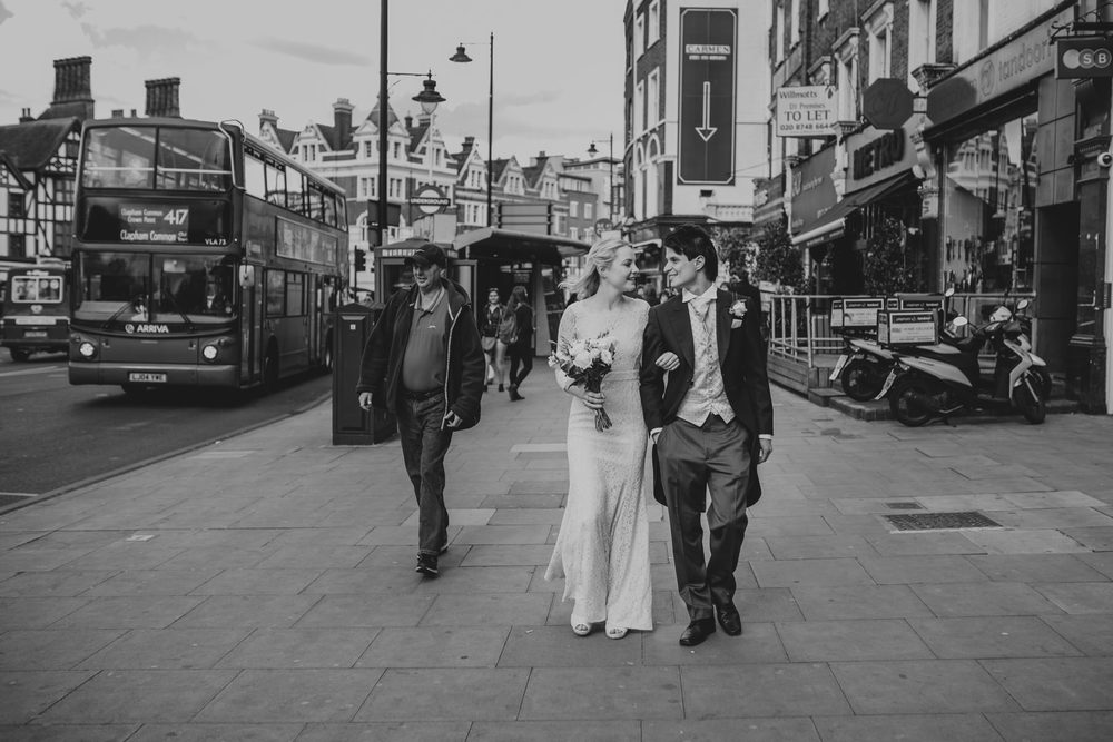 LD-377-BW-newly-married-bride-groom-walking-London-street-photos.jpg