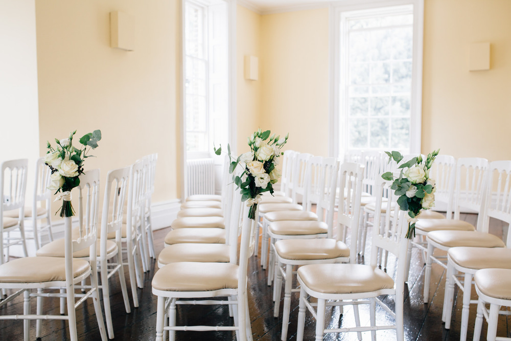 Empty ceremony room Clissold House ceremony room light airy filled with white roses hydrangeas