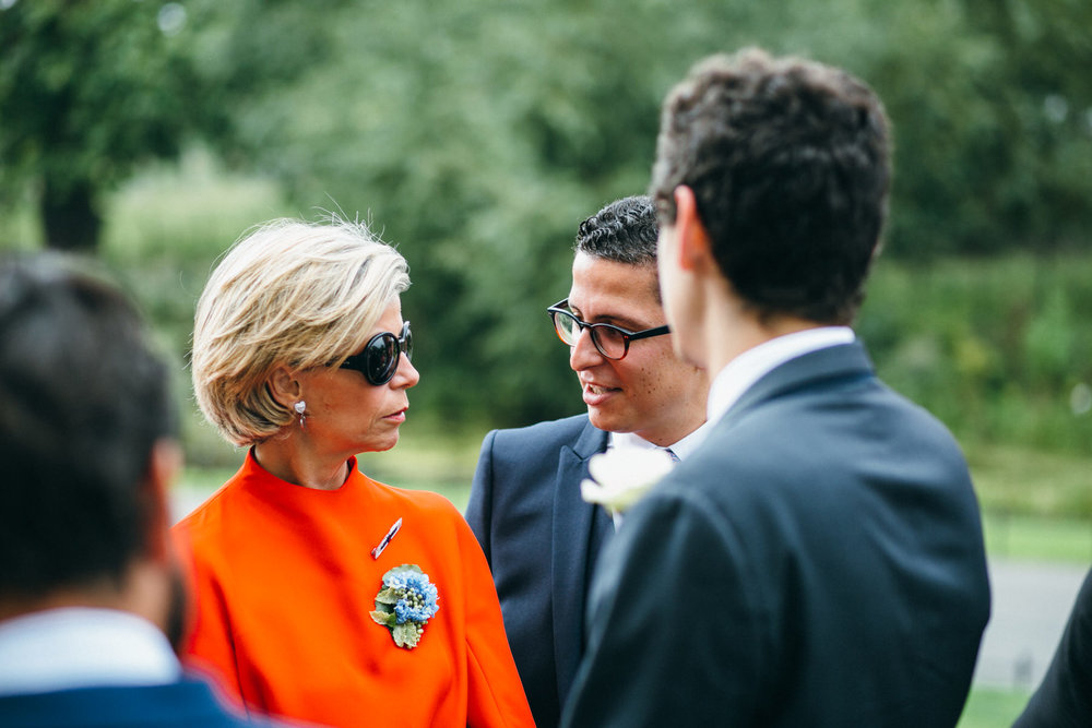 mother of groom talking with groom Clissold House wedding