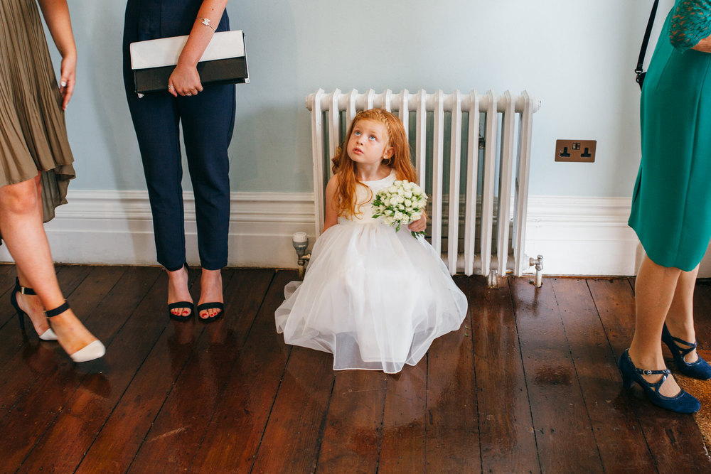 flowergirl sitting on floor waiting for bride Clissold House