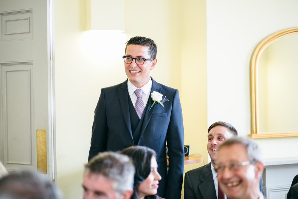 groom in yellow ceremony room Clissold House