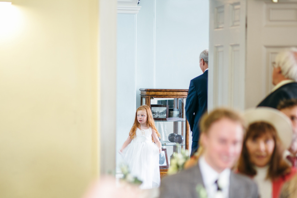 flowergirl waiting to come into ceremony room Clissold House