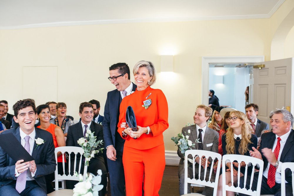 mother of the groom enters Clissold House yellow ceremony room