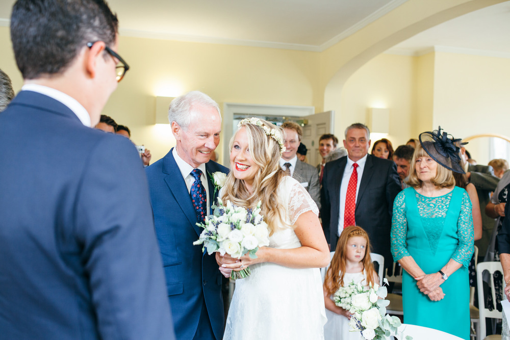 bride sees groom first time Clissold House on fathers arm