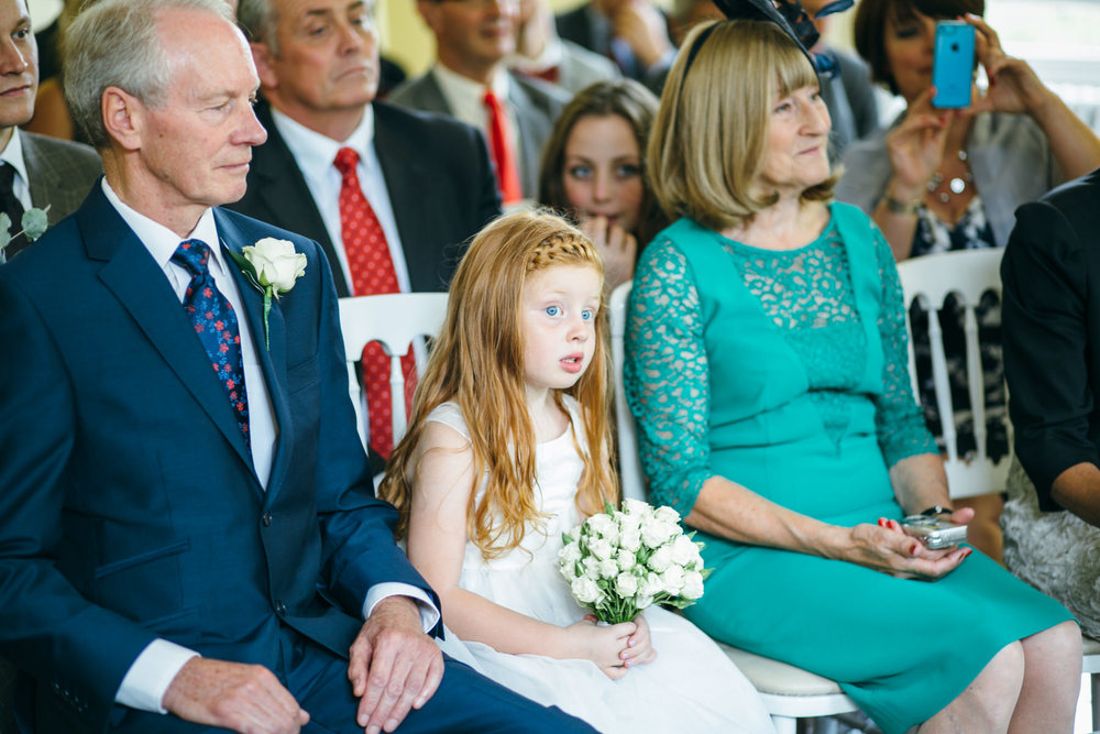 flowergirl watching Clissold House wedding ceremony